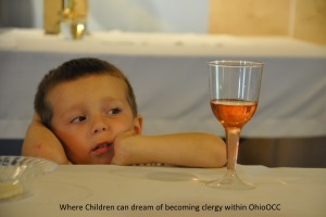 Little Boy dreaming of becoming clergy while stirring at the sacraments